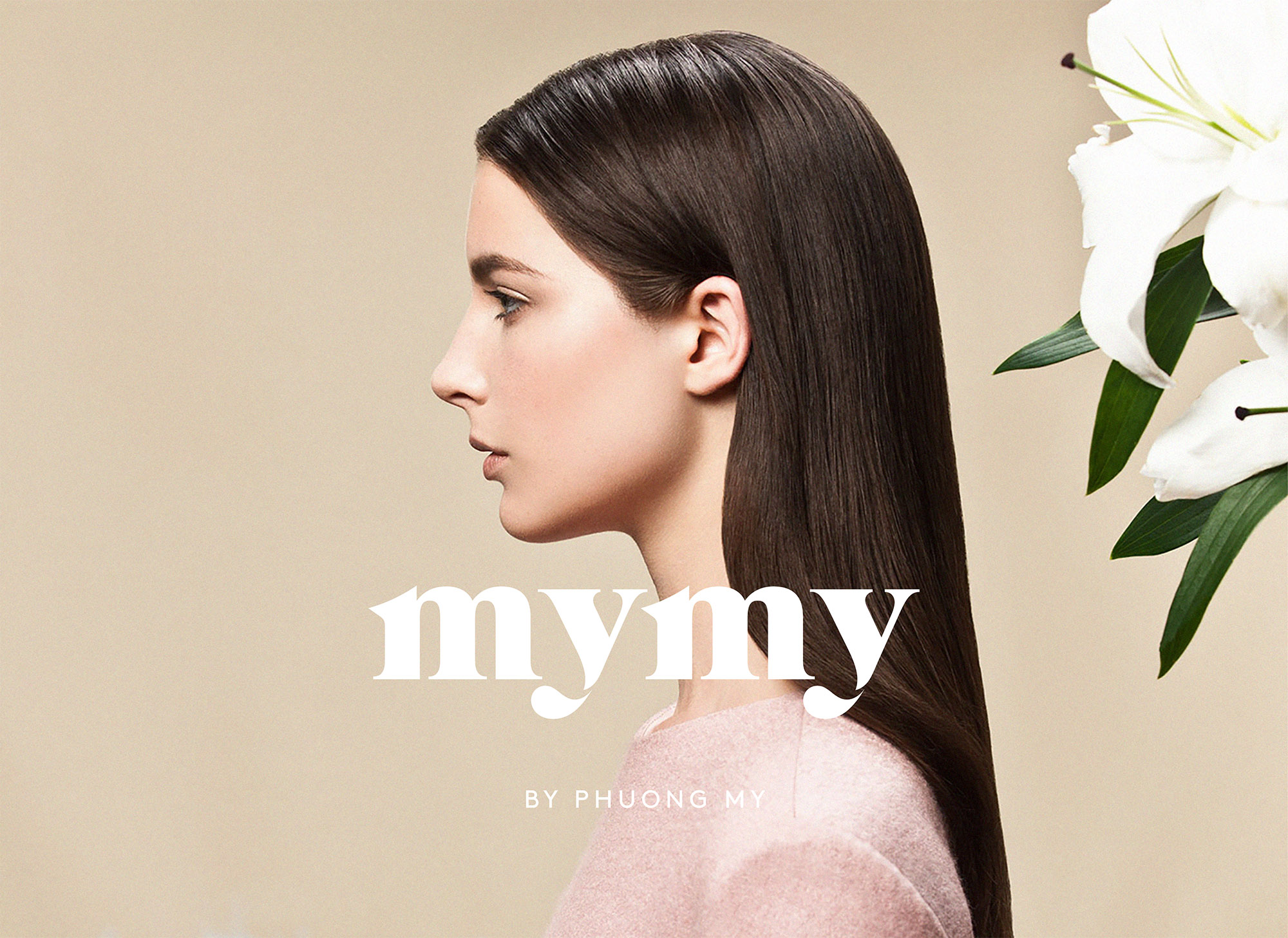 MYMY logo in front of girl with brown hair on a pink background